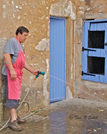 BLUE DOOR, RED APRON - EYEGELAIRE, FRANCE
