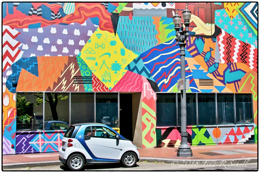 Graffiti covered wall with mini car