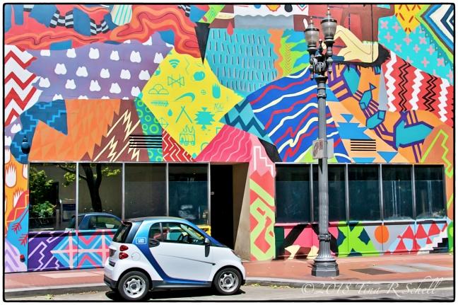 Graffiti covered wall with mini car