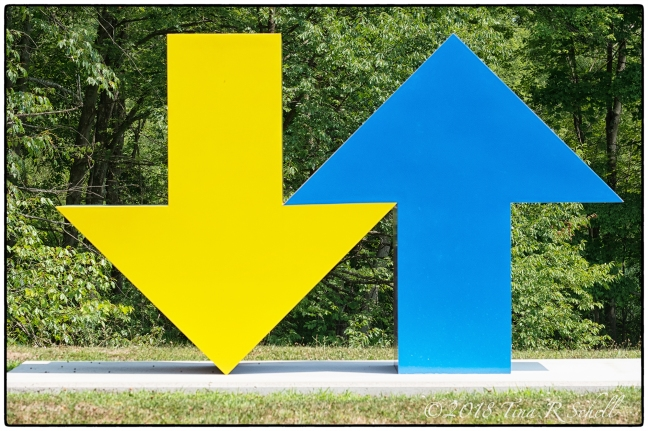 Blue, Yellow Up and Down arrow sculpture