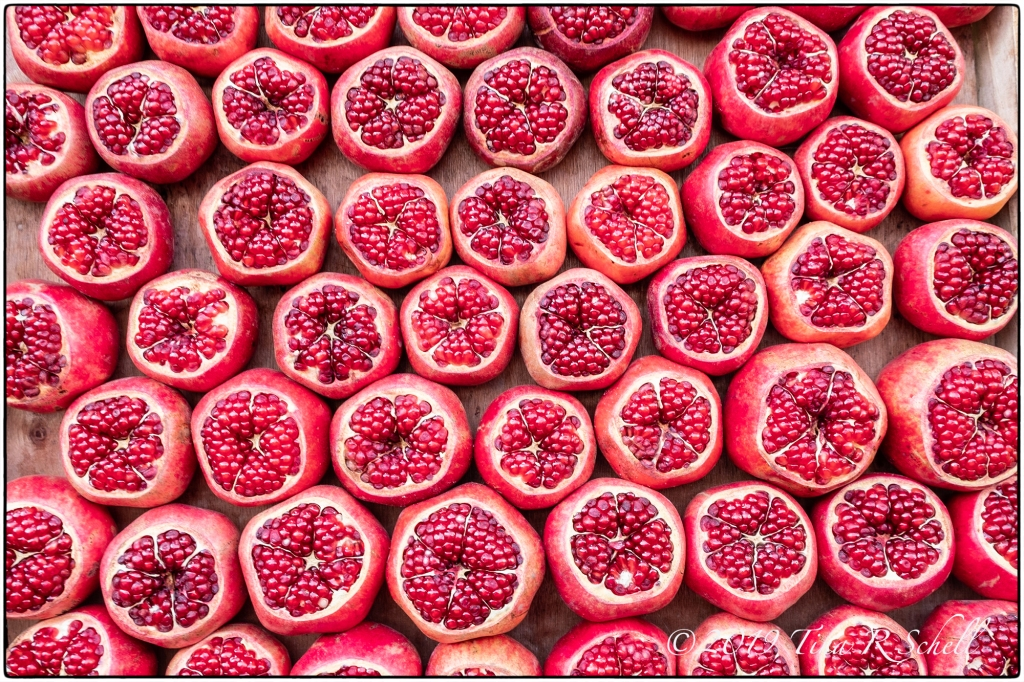 POMEGRANATE display in a farmers market