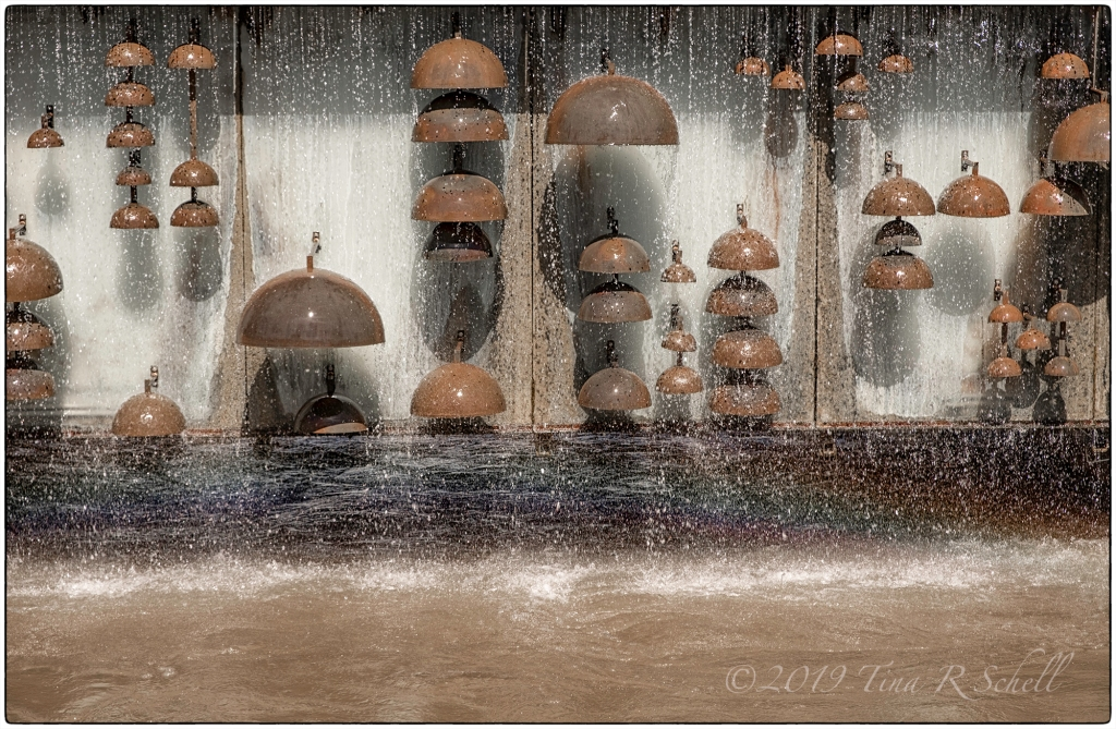 Scottsdale water fountain with metal umbrellas