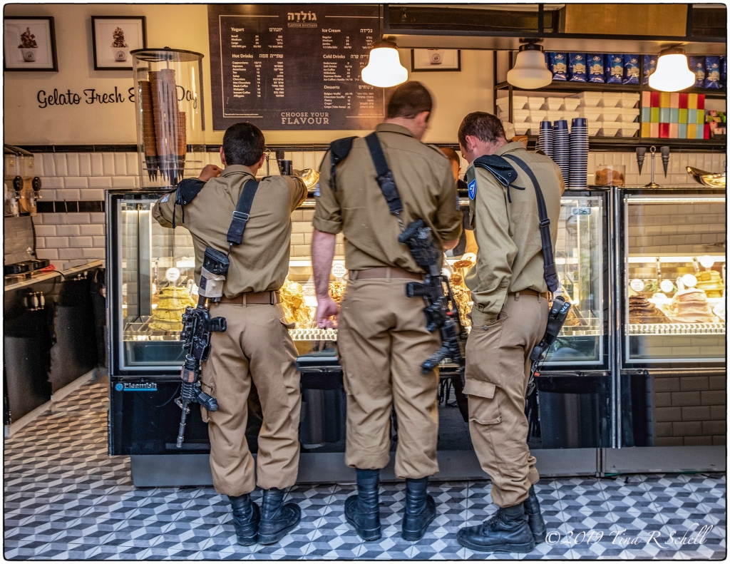Three Israeli soldier at gelato bar