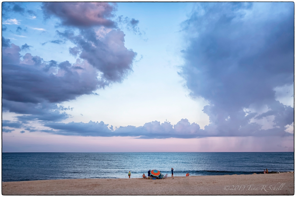 beach umbrella under clouds