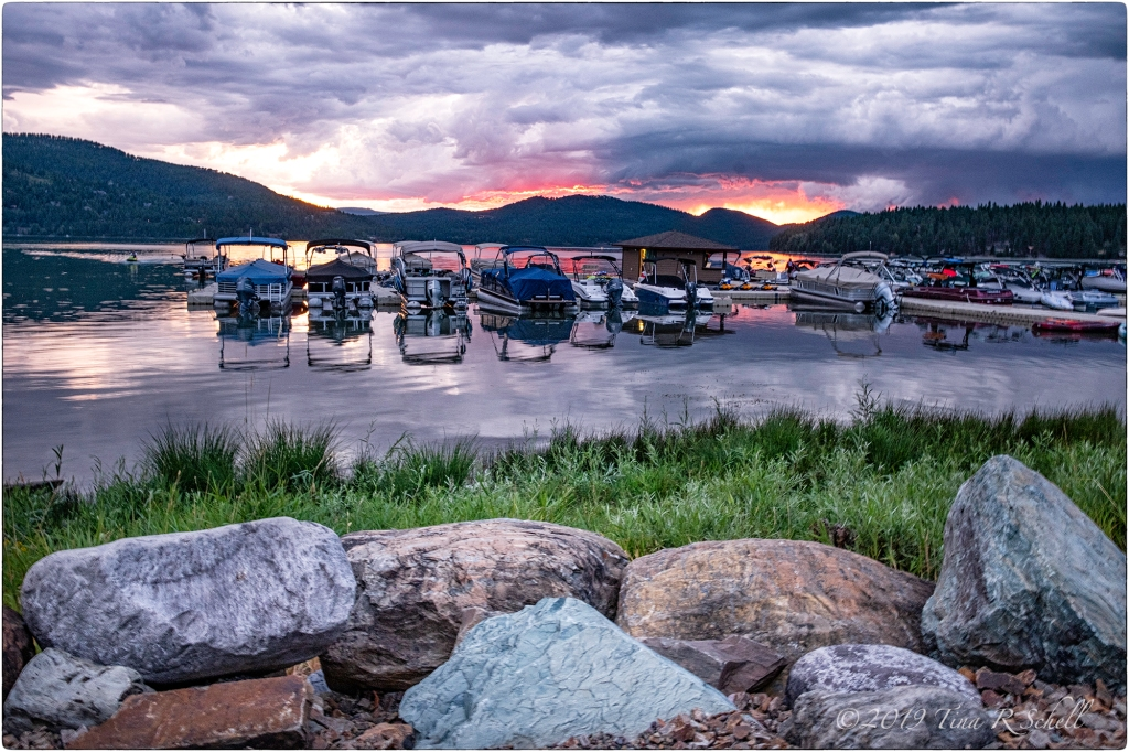 SUNSET, WHITEFISH LAKE, MONTANA, BOATS, ROCKS