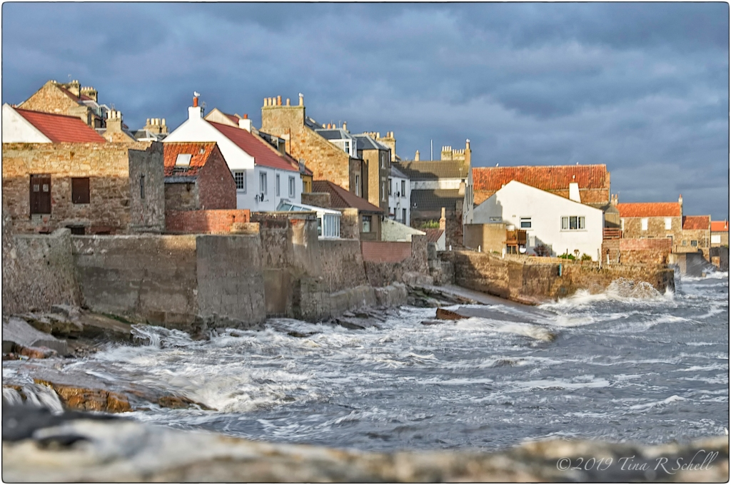 small scottish town, rough sea