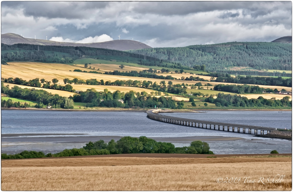 Bridge over water between farmlands in Scotland
