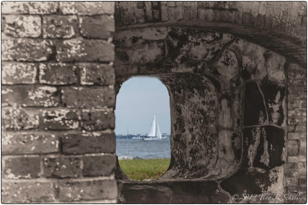 Fort Sumter with sailboat through the window