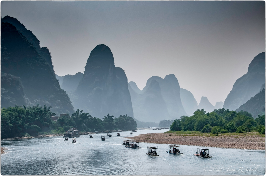 boats heading down river, karsts