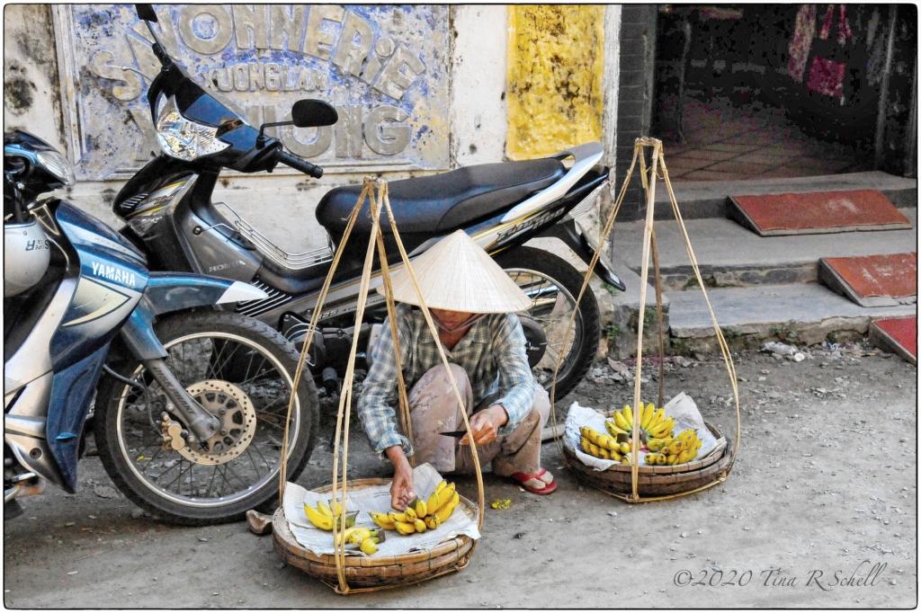 vietnamese worker, baskets, motorcycle