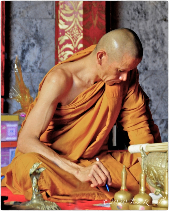 monk, bald, colorful, writing