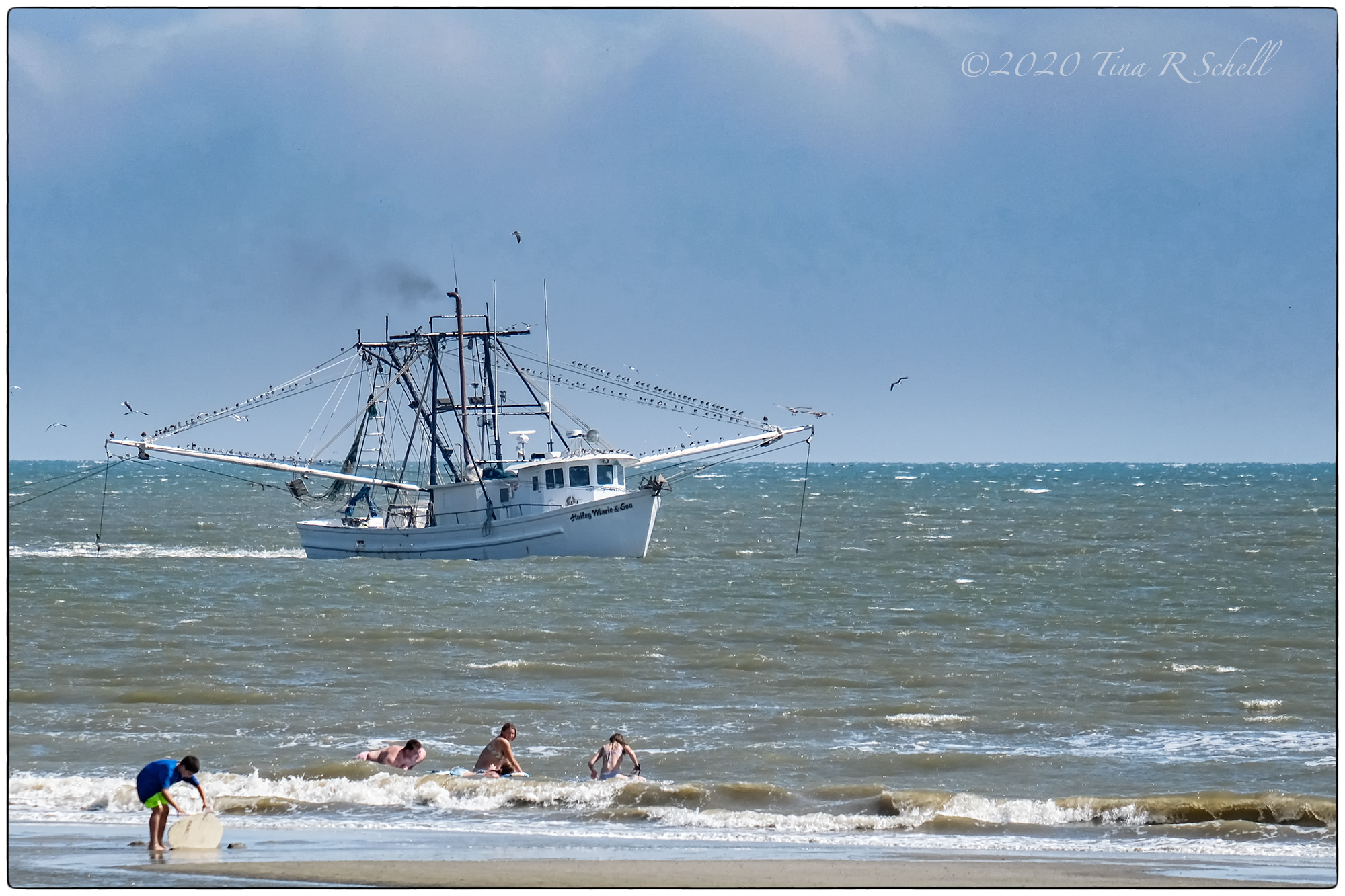 shrimp boat, ocean, swimmers