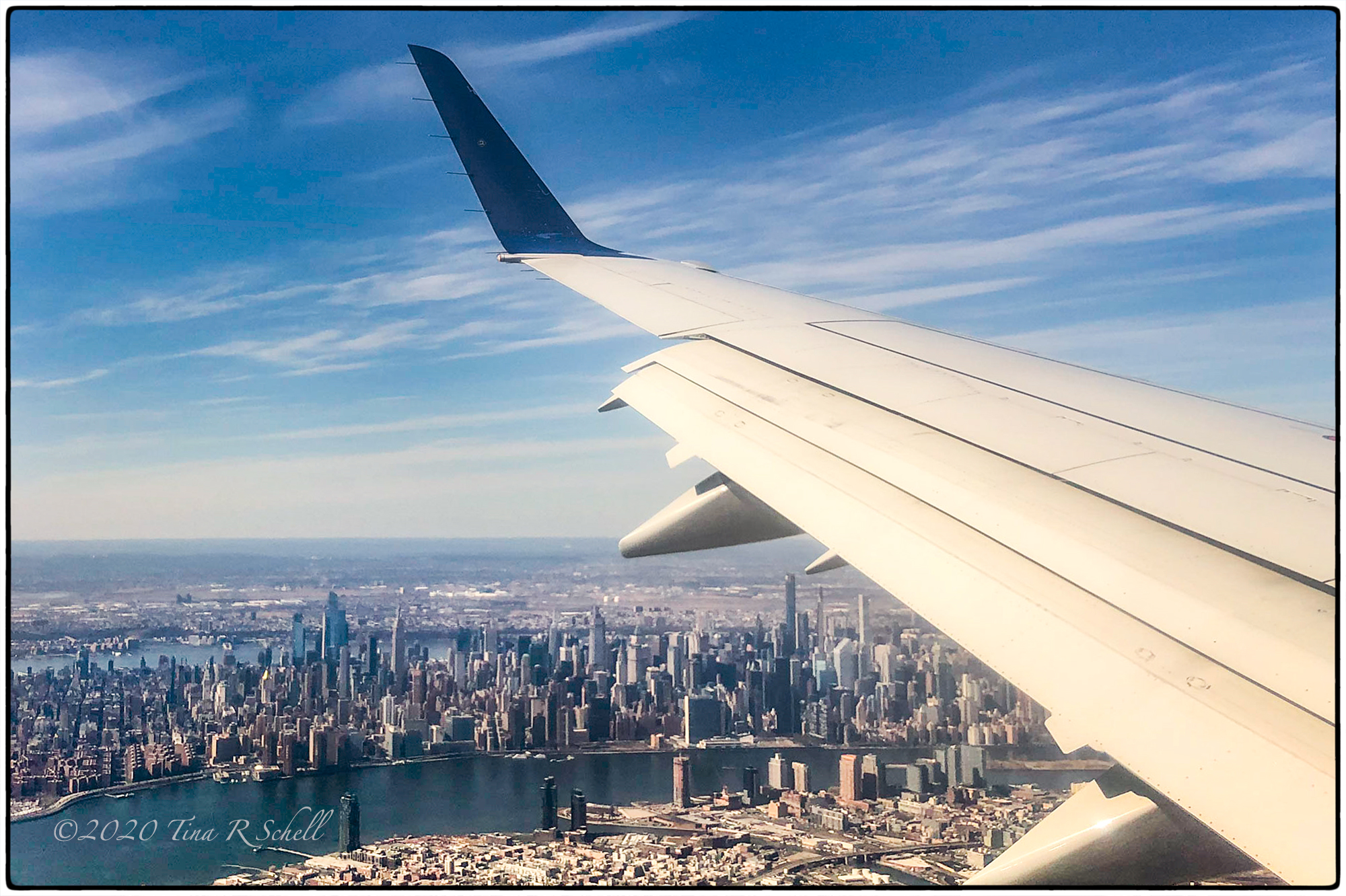 airplane wing over NYC