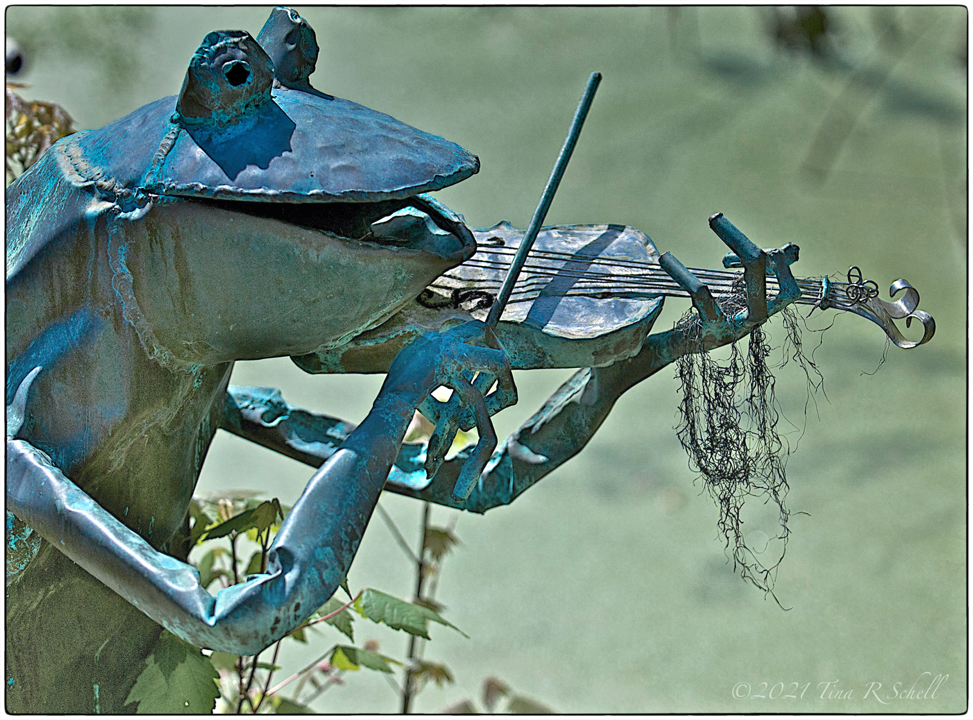 metal frog, statue, violin
