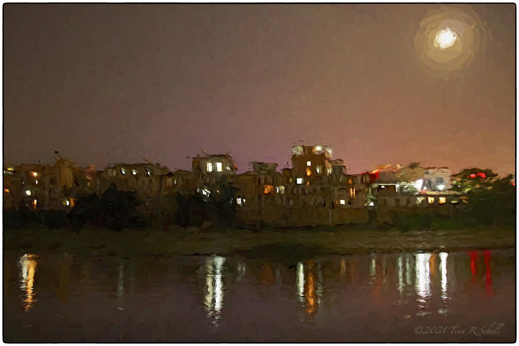 Nightfall, full moon, city lights